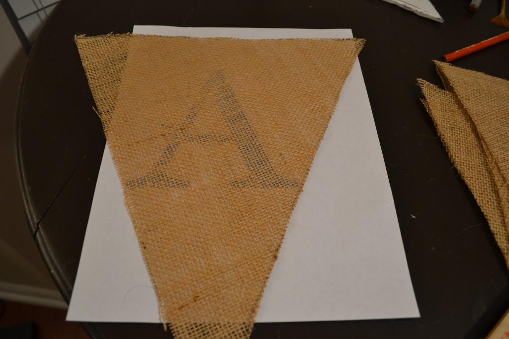 put letter under burlap and trace1 1024x682 DIY Burlap Pennant Banner