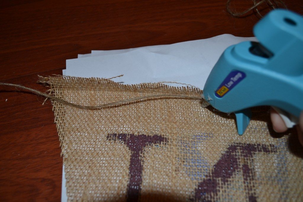 put string under fold and glue1 1024x682 DIY Burlap Pennant Banner