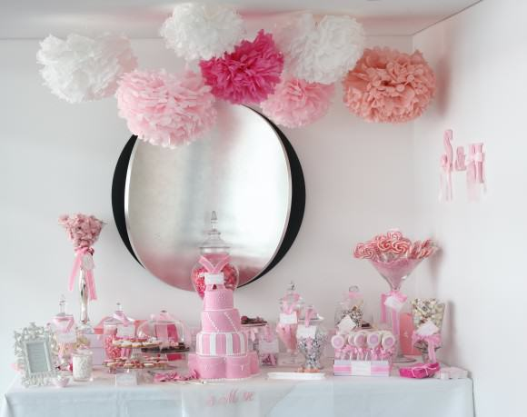 pink white wedding dessert candy buffet tissue paper pom poms 580x459 How to Create a Candy Buffet