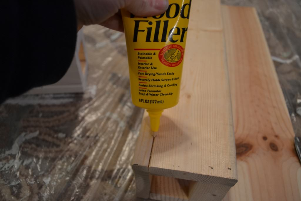 apply wood putty in the area where the base and front attached 1024x682 Build and Mod Podge a Wall Mount Bookshelf {DIY Tutorial}